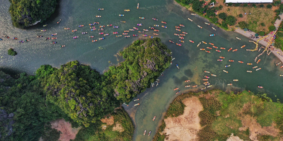 A river tour at Trang An is shot from above. Photo: Mai Thuong / Tuoi Tre