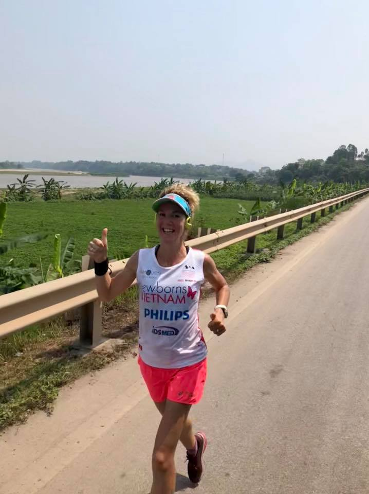 "A picture of Marieke Dekkers posted on The Red River Run Facebook page with the caption reading ""90km covered and Marieke is going strong with the Red River in the background."" Photo: Red River Run"