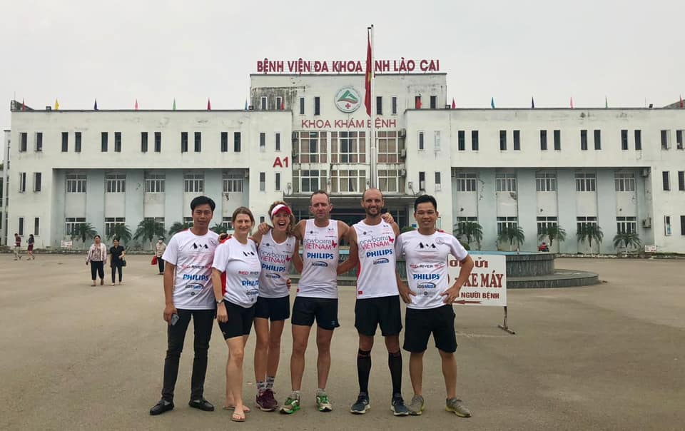 Rob West (2nd from R), Grant Bowdery (3rd from R) and Marieke Dekkers (3rd from L) posed for a picture at the Lao Cai Obstetrics Hospital in the namesake northern province, the final stop of the Red River Run on April 23, 2019. Photo: Red River Run