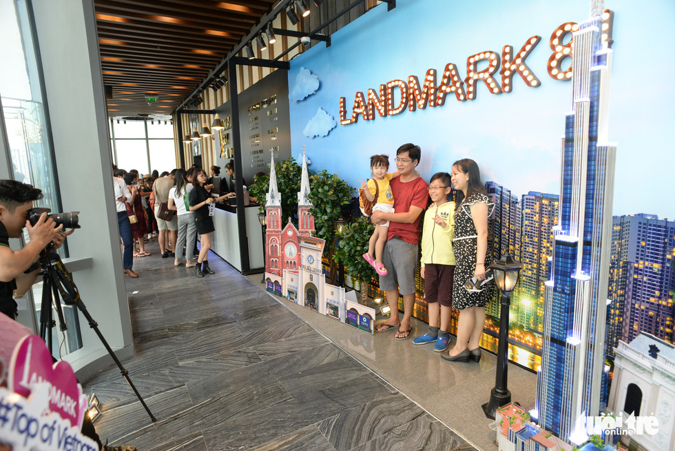 A family poses for a photo at the Landmark 81 SkyView.