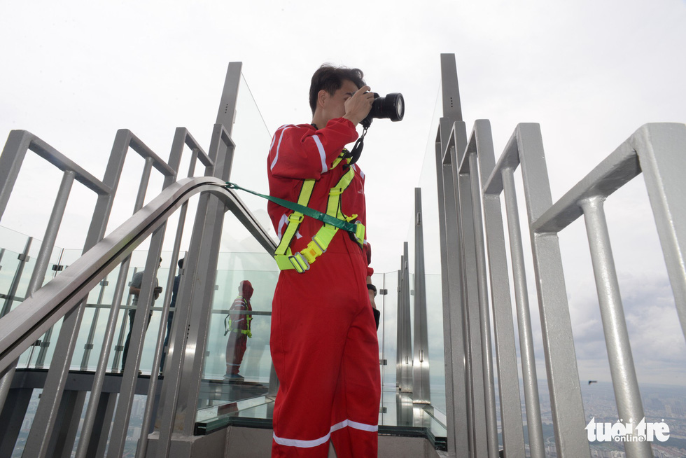 Visitors are equipped with protective gears on the 81st floor.