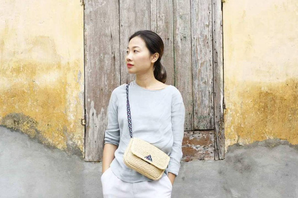 Hai Minh with a raffia and cotton Leinné bag. Photo: Supplied