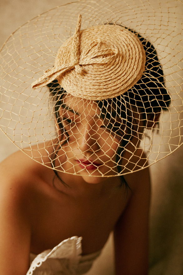 A model poses in Leinné hat made of raffia. Photo: Supplied