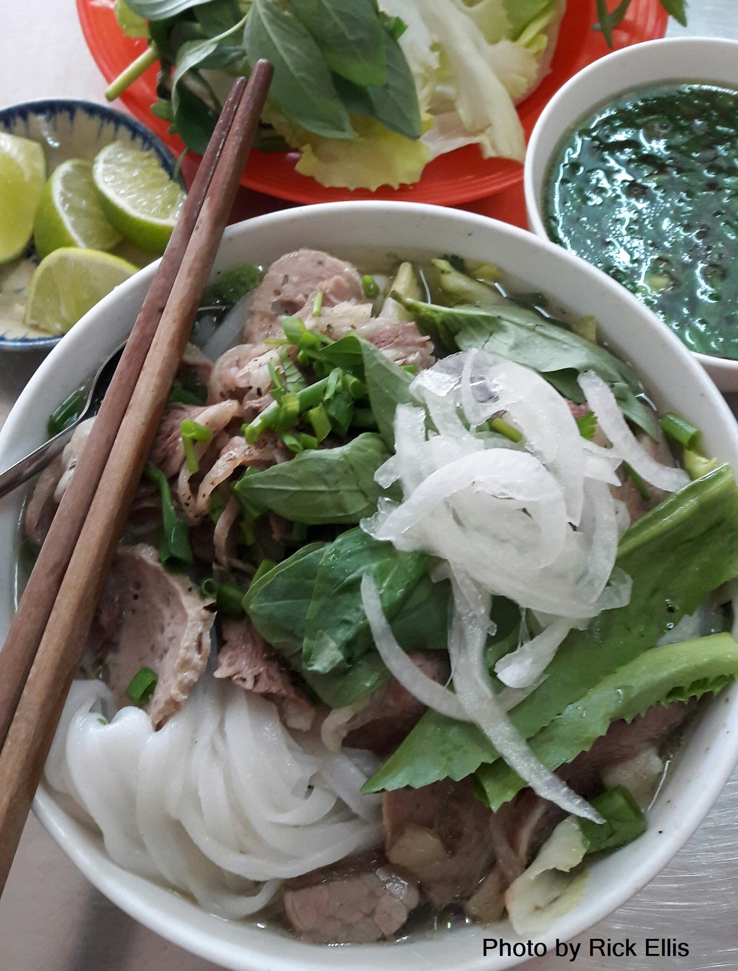 A hearty bowl of pho with the fixings