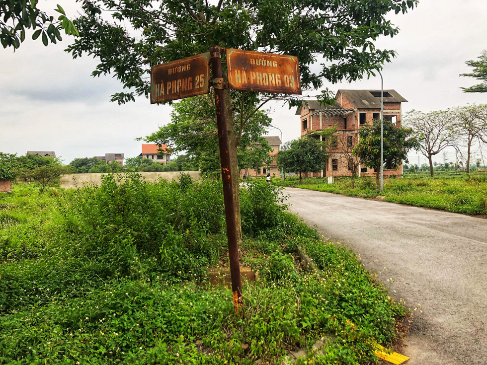 Rusted street signs along an abandoned road