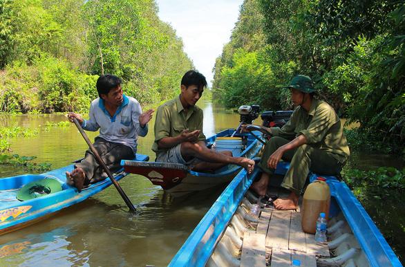 Vietnamese farmers volunteer to protect Mekong Delta nature reserve