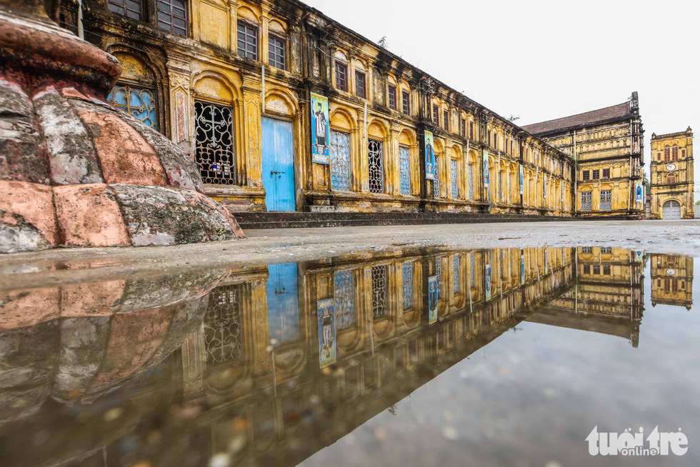 Reflection of the Bui Chu Cathedral in Nam Dinh Province, Vietnam is seen on a puddle. Photo: Nguyen Khanh / Tuoi Tre