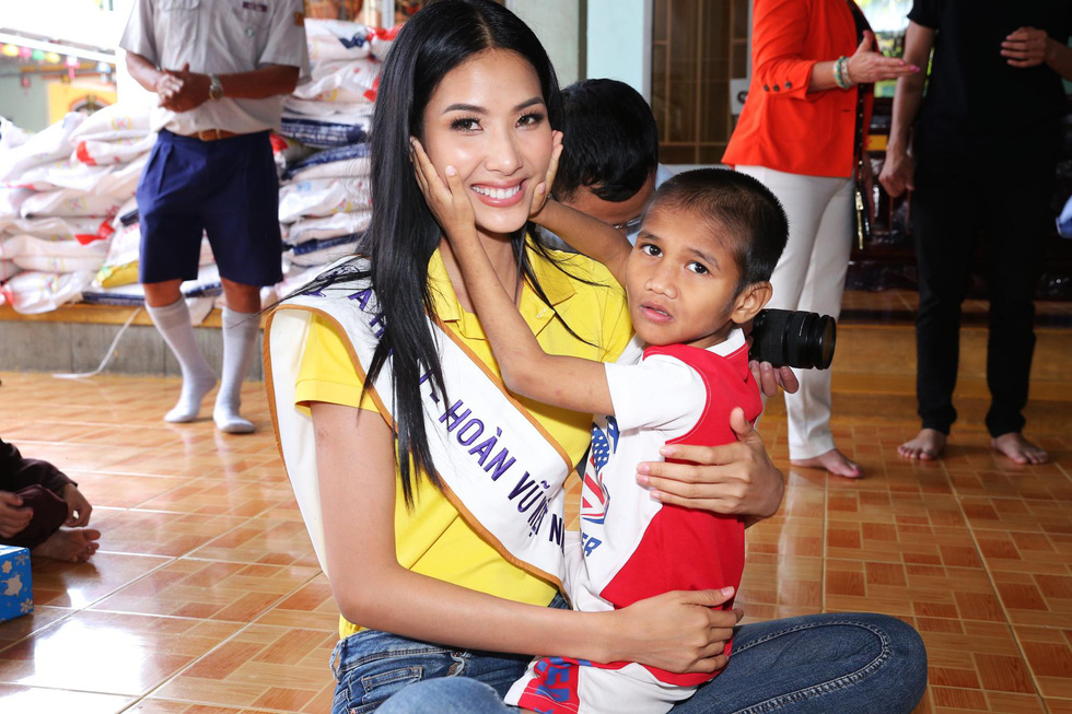Hoang Thuy plays with a boy during a charity event in this photo posted on her Facebook profile.