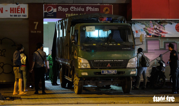 A vehicle carrying people believed to be members of Nhat Cuong Mobile leaves the company's headquarters.