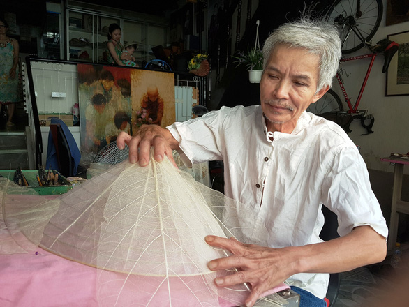 Vietnamese man makes traditional conical hat from almond leaf