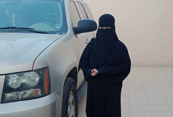A Vietnamese maid in Saudi Arabia is seen fully covered as she leaves the house. Photo: Supplied