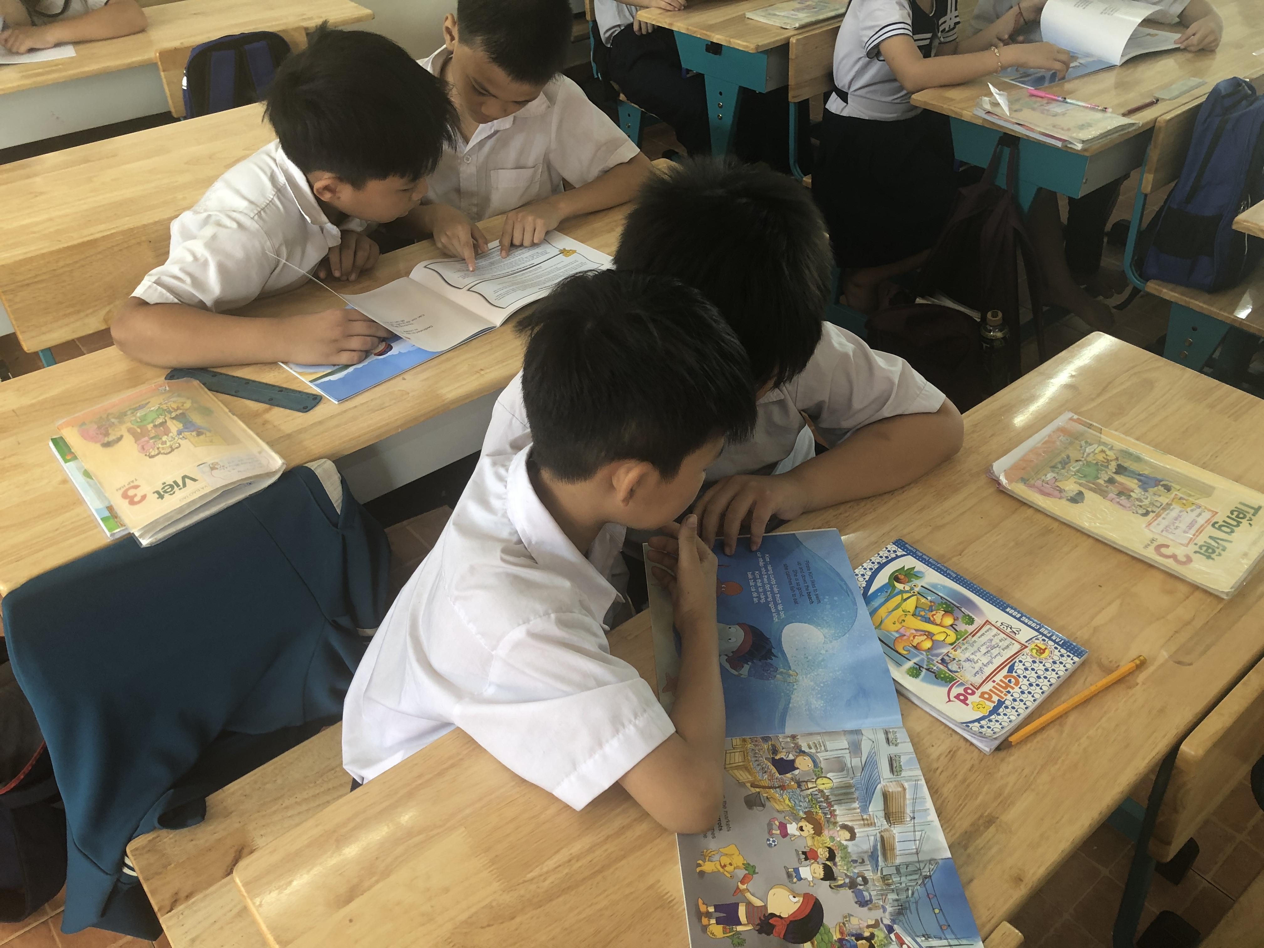 Boy & boy at desk: Maison Chance HCMC