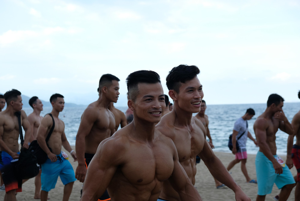 Contestants of the beach bodybuilding competition stride Tran Phu beach in Nha Trang, Khanh Hoa, south-central Vietnam, on May 13, 2019. Photo: Dinh Cuong / Tuoi Tre