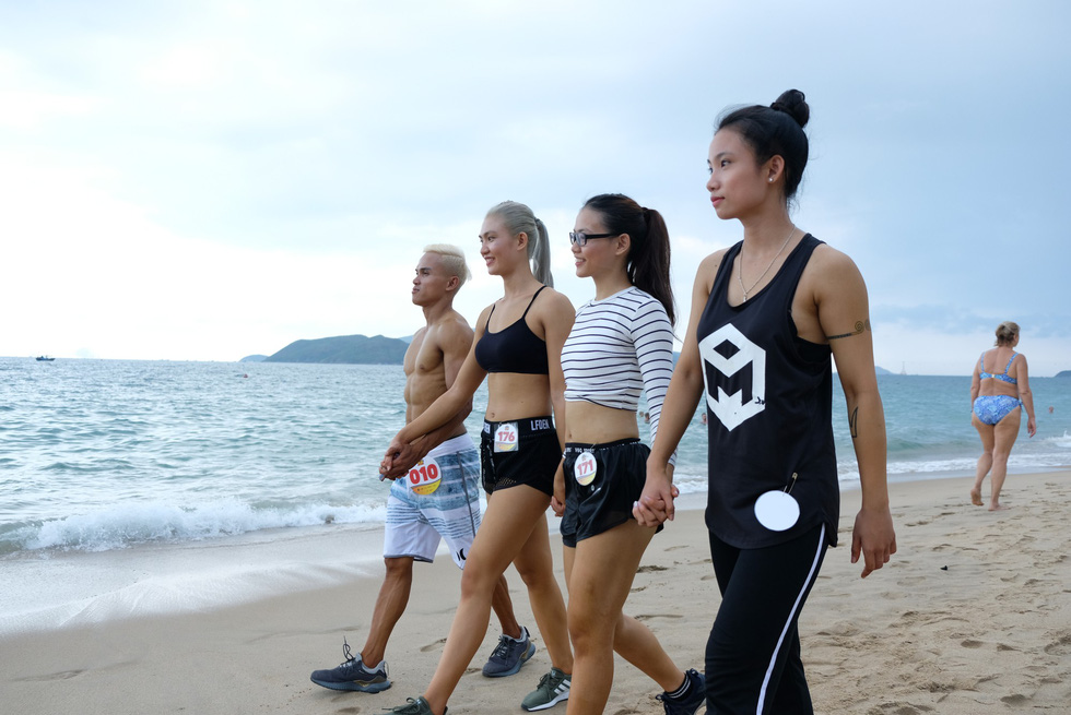 Contestants of the beach bodybuilding competition stride the Tran Phu beach in Nha Trang, Khanh Hoa, south-central Vietnam, on May 13, 2019. Photo: Dinh Cuong / Tuoi Tre