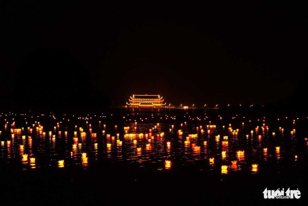Thousands of water lanterns float on a lake at the Tam Chuc Pagoda in Ha Nam, northern Vietnam, on May 13, 2019. Photo: Nam Tran / Tuoi Tre