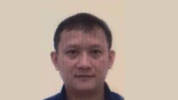 Bui Quang Huy, general director of Nhat Cuong Mobile, in this photo provided by officers