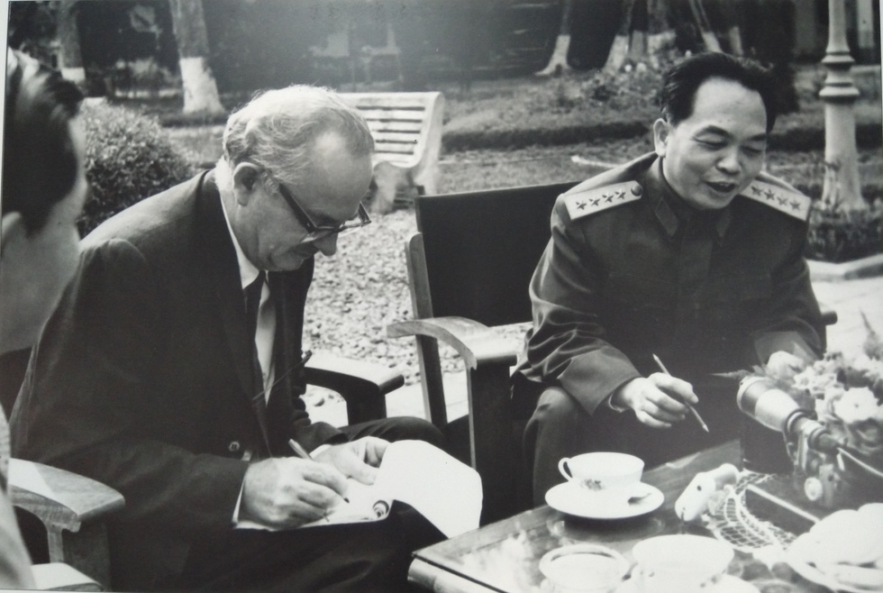 Wilfred Burchett (L) and Vietnamese General Vo Nguyen Giap sit for an interview in Hanoi in 1964.