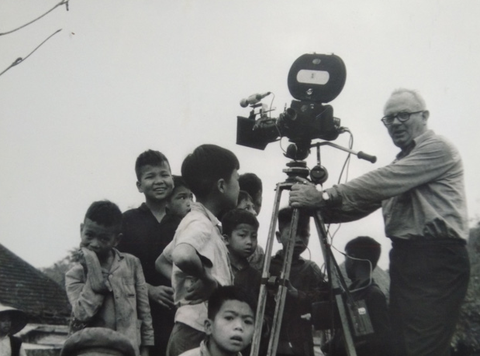 Wilfred Burchett surrounded by Vietnamese children while working in northern Vietnam in 1966.