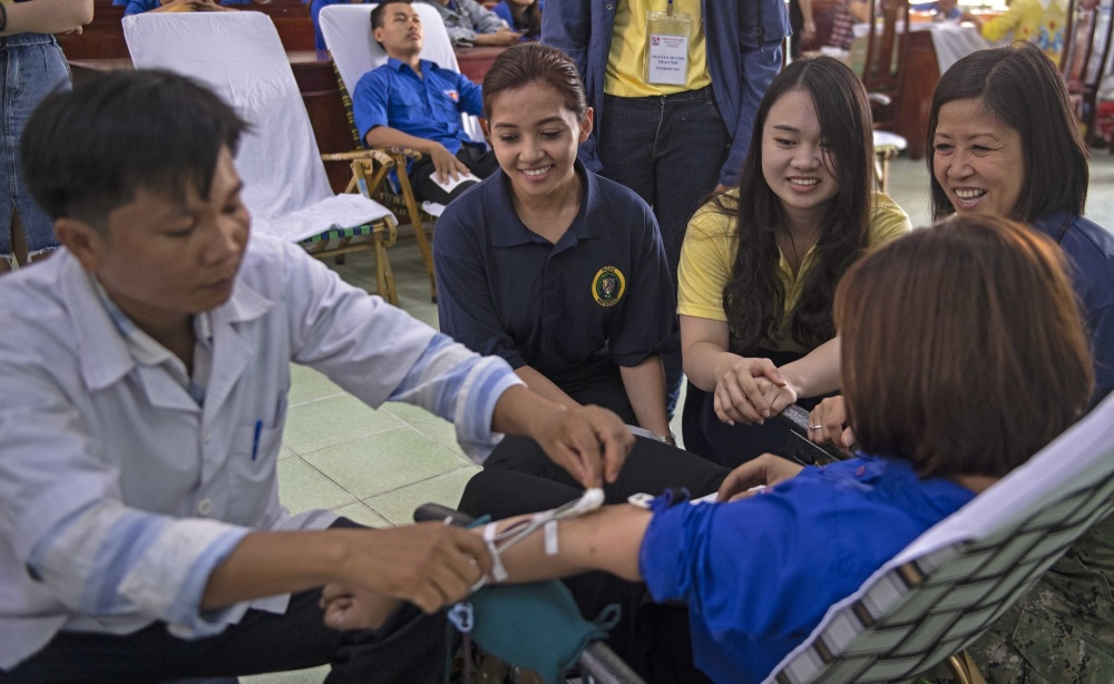 U.S. Navy Hospital personnel talk to a Phu Yen Medical College student during a blood drive to deepen strategic partnerships during Pacific Partnership 2019 in Tuy Hoa, south-central Vietnam, May 13, 2019. U.S. Navy photo