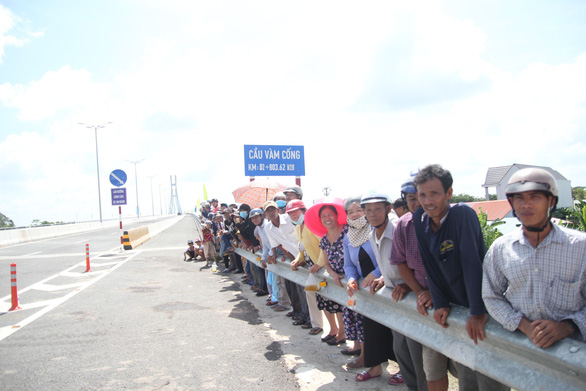 Local residents witness the inauguration of the bridge.