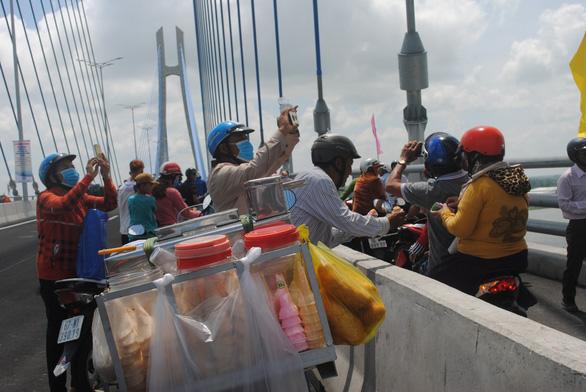 People take photos on the bridge.