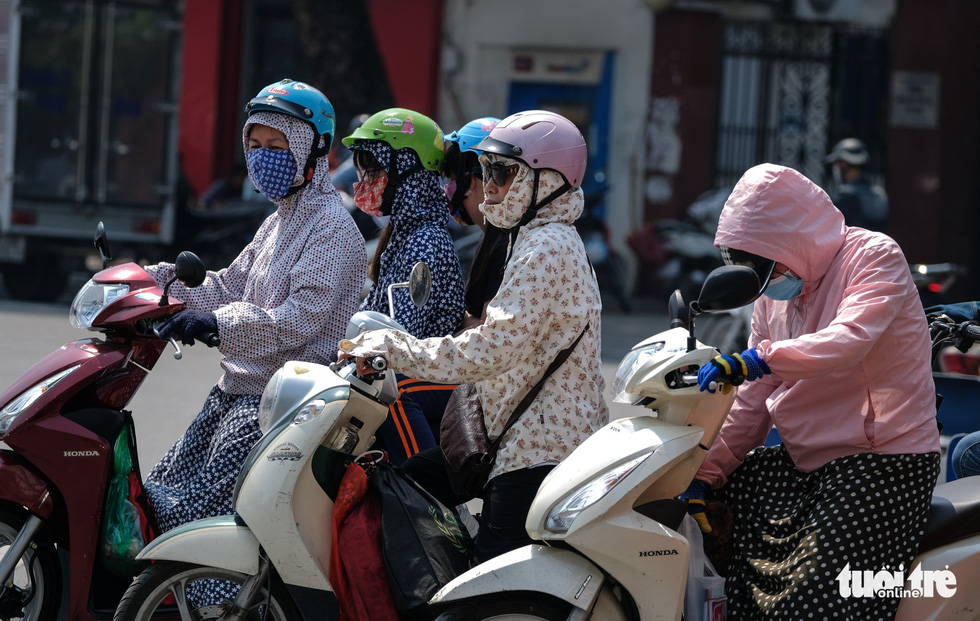 Commuters travel on a street in Hanoi.