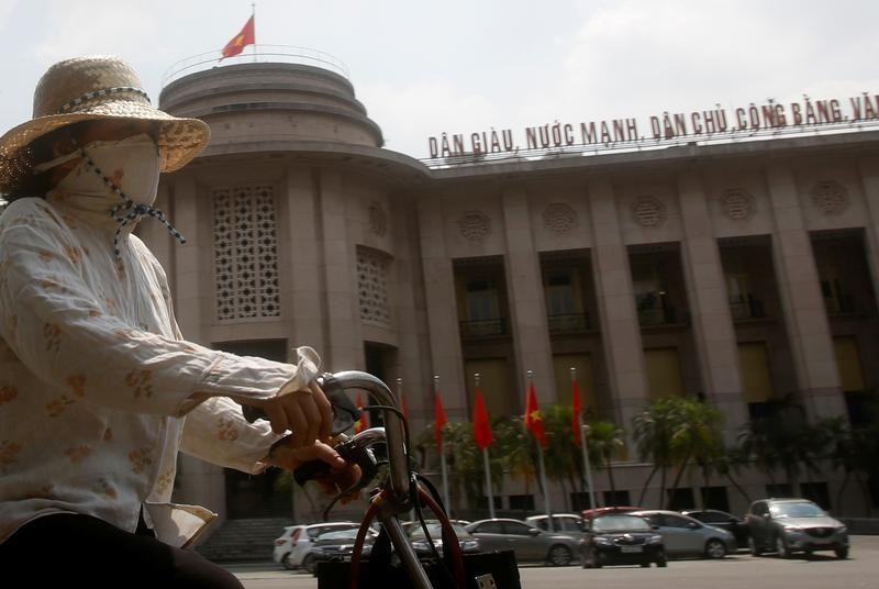 Vietnam central bank says ready to sell dollars to support dong