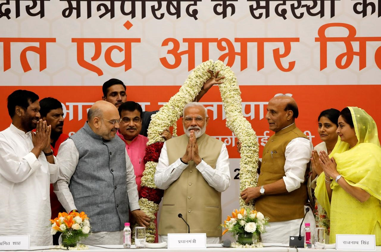 Confident of poll win, Modi's alliance promises to boost India's economy