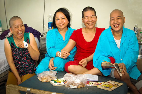 A group of cancer patients laughing over snacks and great conversation. Photo: Dang Huu Hung