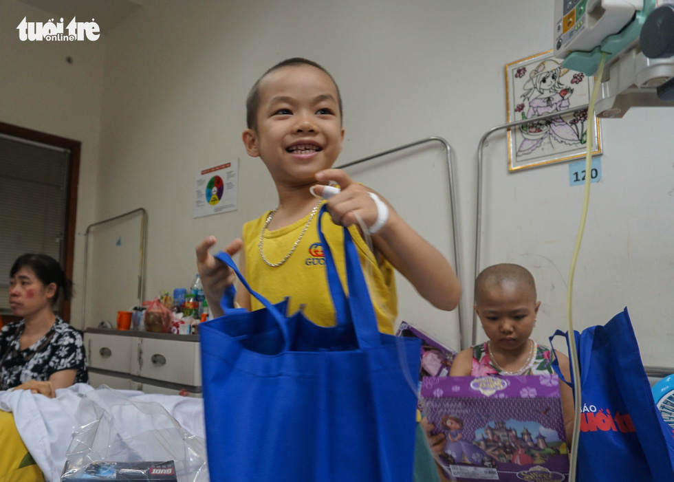 A boy smiles in happiness as he receives his gift at an oncology hospital in Hanoi. Photo: Nguyen Hien / Tuoi Tre