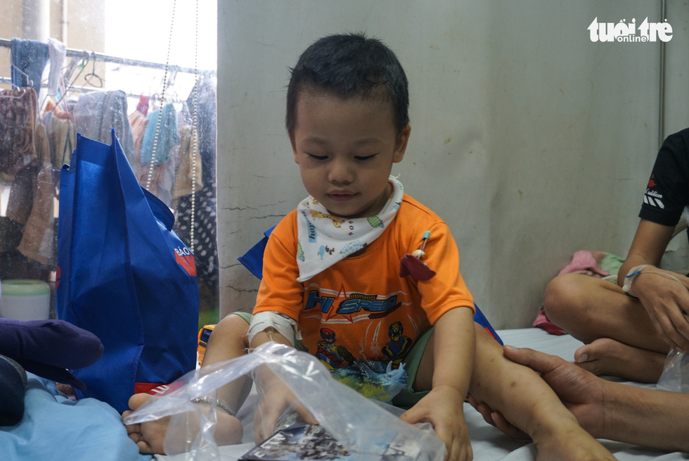 A boy smiles in happiness to see new toys at an oncology hospital in Hanoi. Photo: Nguyen Hien / Tuoi Tre