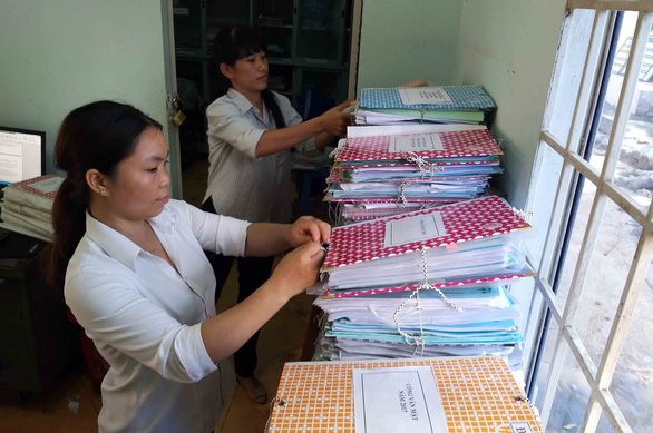 Officials in Suoi Trau Commune of Dong Nai Province, Vietnam organize papers before the commune's scheduled dissolution on June 1, 2019. Photo: H. Mi / Tuoi Tre