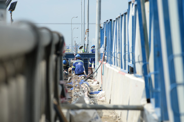Works being carried as part of the expansion of the bridge. Photo: Tu Trung / Tuoi Tre