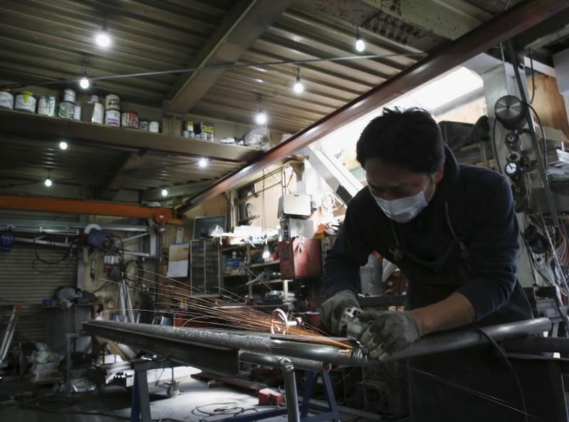 Factory activity shrinks across Asia, stokes global recession fears