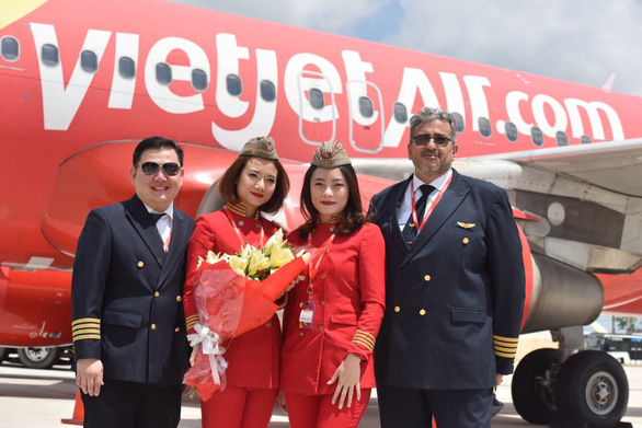 A Vietjet crew is pictured before a charter flight that carried some 300 passengers from India to Phu Quoc Island off Kien Giang Province, Vietnam to attend a Indian billionaire couple's wedding in March 2019. Photo: Vietjet Air
