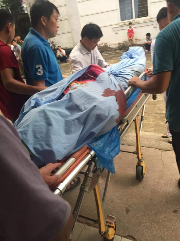 A border guard officer is brought to the hospital in this photo provided by local residents.