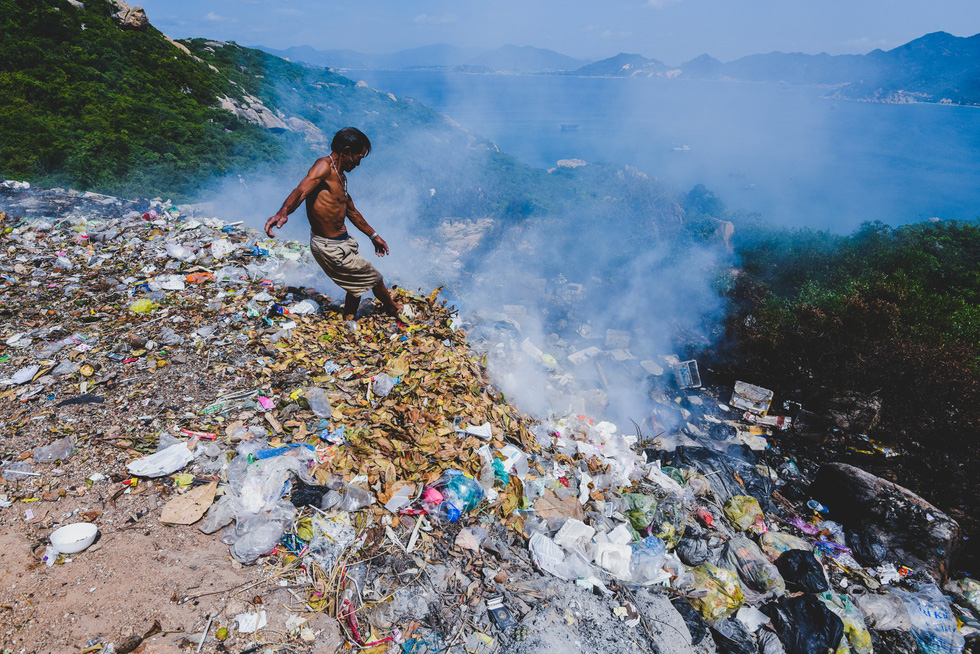 A man burns garbage on Binh Ba Island off the south-central city of Nha Trang.