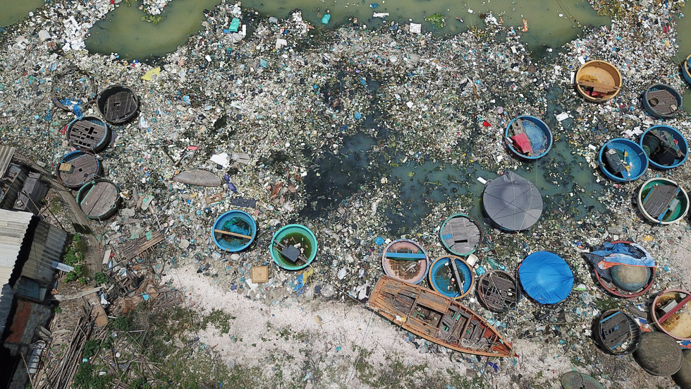 Basket boats amid a sea of garbage in the south-central province of Binh Thuan