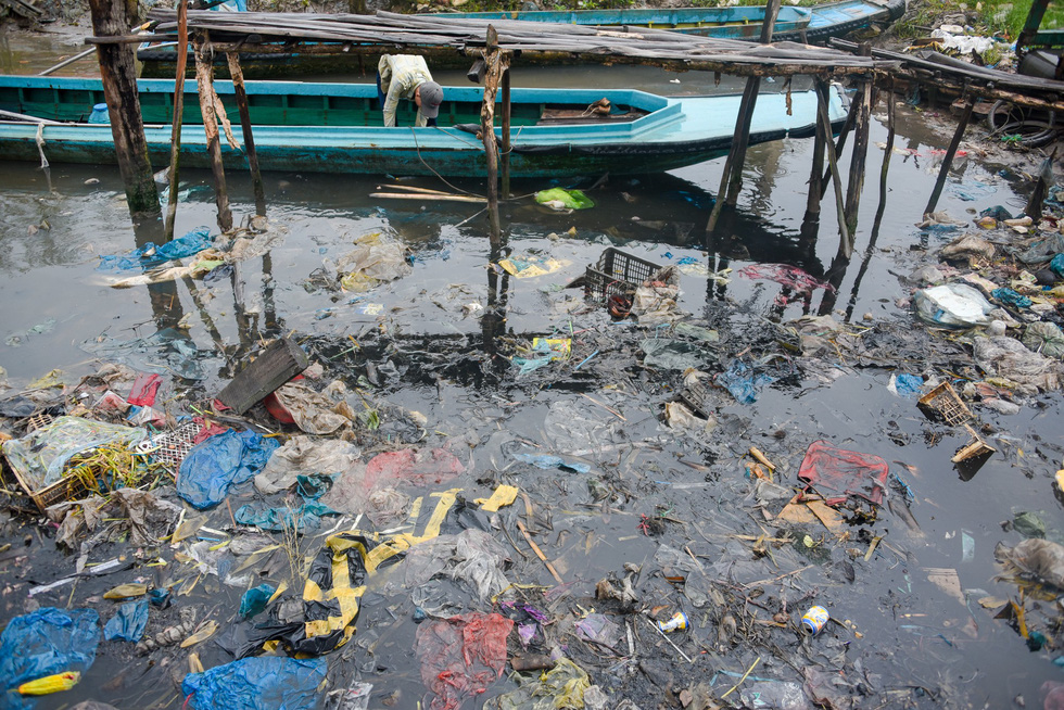 A polluted dock in the Mekong Delta province of Ca Mau