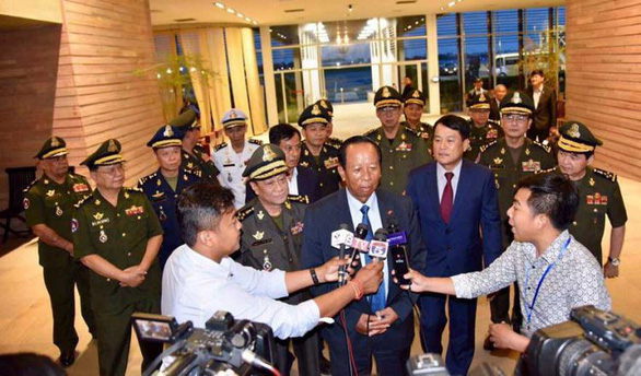 Cambodian Defense Minister General Tea Banh is surrounded by reporters at an airport in Phnom Penh, Cambodia after returning from the 18th Shangri-la Dialogue in Singapore on June 3, 2019. Photo: Facebook