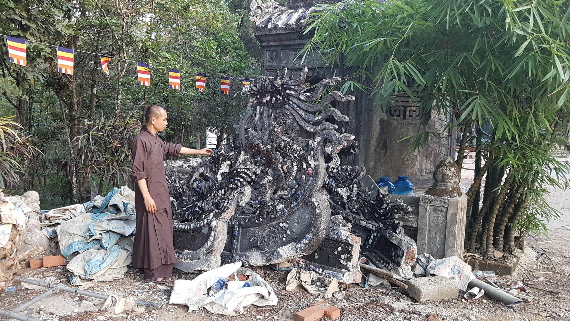 A wall sculpture removed from the main structure of the Tu Hieu Pagoda in Hue, Vietnam. Photo: Thai Loc / Tuoi Tre
