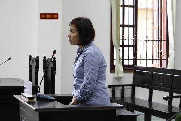 Nguyen Thi Nga stands her trial at the People's Court in Binh Thanh District. Photo: Ngoc Phuong / Tuoi Tre
