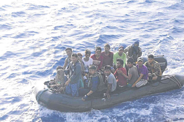 Filipino fishermen on a ship that sank off Vietnam's Truong Sa (Spratly) archipelago on June 9 after being hit by a Chinese vessel are brought to safety. Photo: Philippine Navy