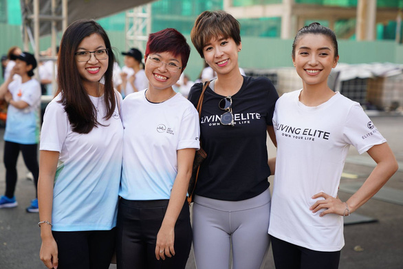 Thuy Muoi (second from left) poses for a photo with her volunteers at the Salt Cancer Initiative. Photo: SCI