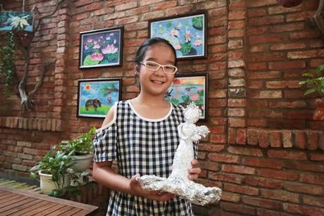Vietnamese eighth-grader raises funds for needy peers via art exhibition