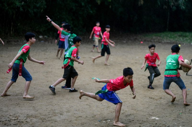Many of the players are barefoot and they train on a makeshift pitch. Photo: AFP