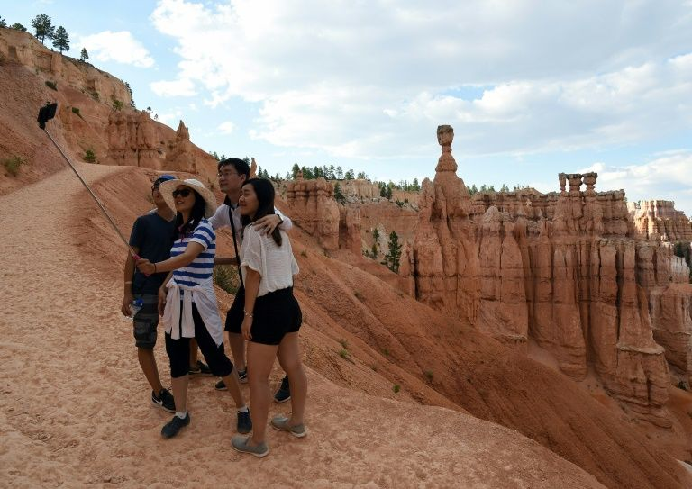 Visitors take a selfie in Bryce Canyon National Park, in the US state oi Utah. Photo: AFP
