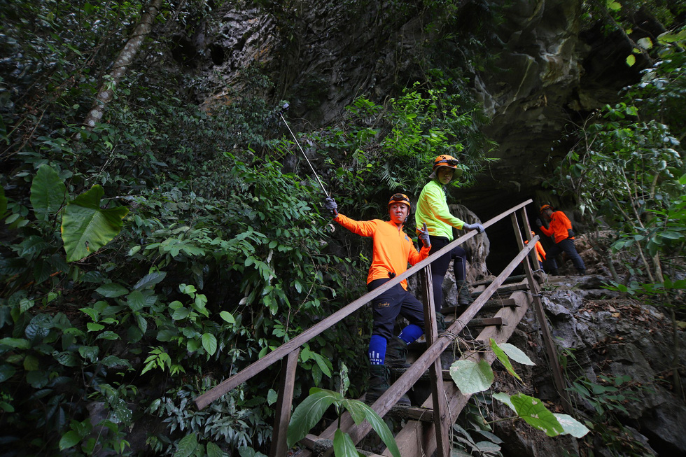 One YouTuber (orange) takes a photo before entering Tu Lan Cave in Quang Binh Province, north-central Vietnam. Photo: Google Adventure Vietnam