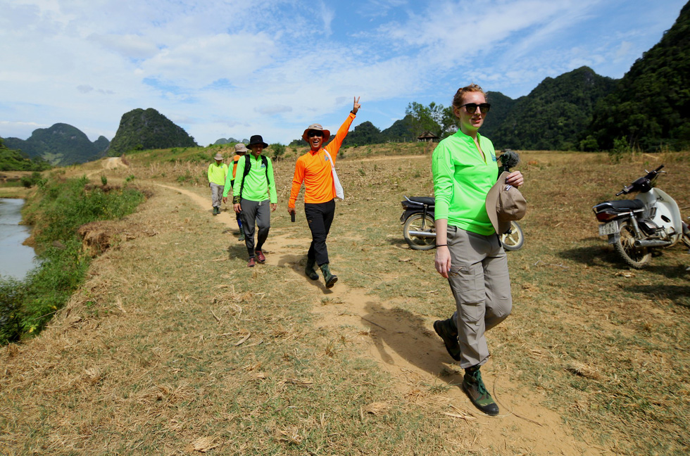 The production team walks to Tu Lan Cave in Quang Binh Province, north-central Vietnam. Photo: Google Adventure Vietnam