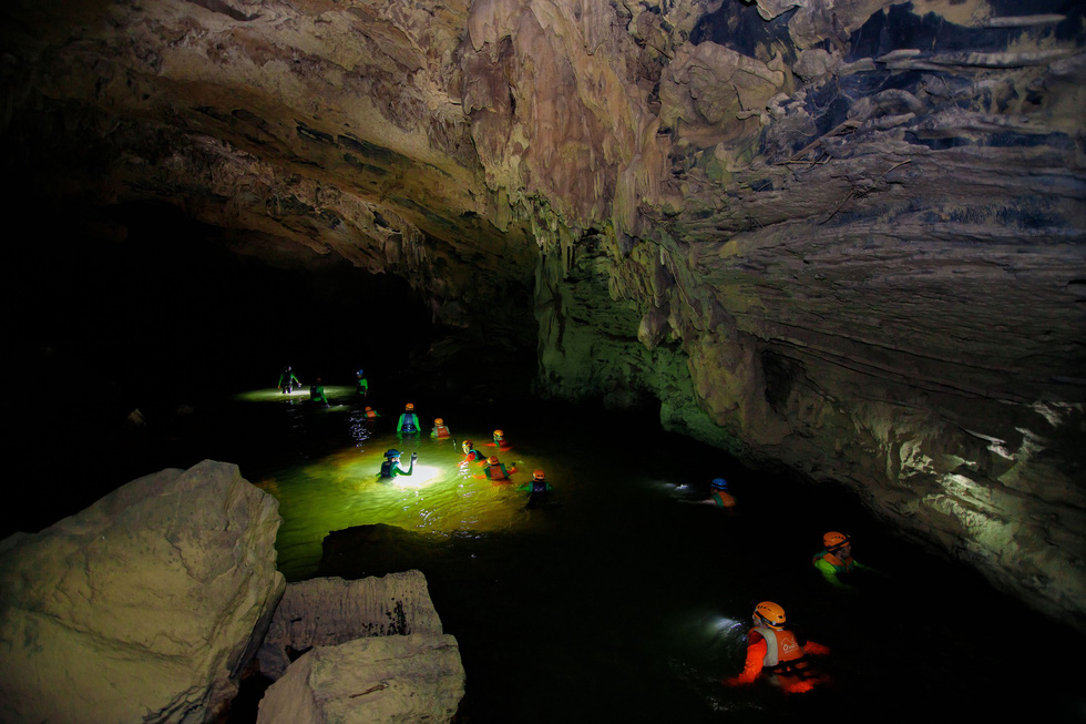 Google Adventure Vietnam production team wades inside Tu Lan Cave in Quang Binh Province, north-central Vietnam. Photo: Google Adventure Vietnam